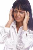 Portrait of Brunette Woman Experiencing Headache in Forehead Royalty Free Stock Image