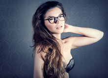 Portrait of brunette woman in glasses. Stock Photos