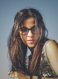Portrait of a brunette woman with glasses Stock Photo