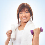 Portrait of a brunette woman holding a dumbbell Stock Photos