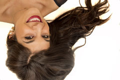 Portrait of a brunette woman laying down smiling looking up Stock Photos
