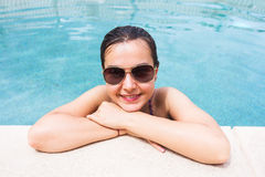 Portrait of a brunette woman at the pool Stock Images