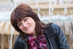 Portrait of brunette woman smiling Stock Photos