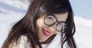 Portrait of brunette woman wearing eyeglasses. Close-up portrait of attractive young brunette woman wearing black framed eyeglasses while smiling and looking at Stock Photos