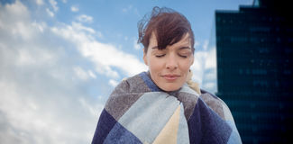 Composite image of portrait of brunette women wearing scarf Royalty Free Stock Photography