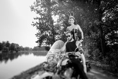 Portrait of brutal biker and beautiful sexy woman on motorcycle Royalty Free Stock Image