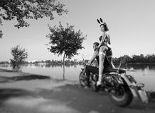 Portrait of brutal biker and beautiful sexy woman on motorcycle Royalty Free Stock Photography