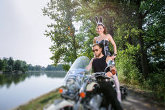 Portrait of brutal biker and sexy girl with motorcycle Royalty Free Stock Photo
