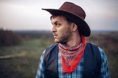 Portrait of cowboy in leather jacket and hat stock image