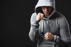 Portrait of brutal looking young guy ready to fight. Stock Photography