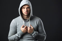 Portrait of brutal looking young guy in sportswear. Stock Photos