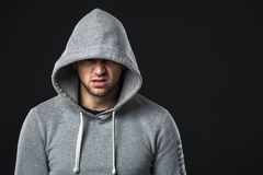 Portrait of brutal looking young guy in sportswear. Royalty Free Stock Photography