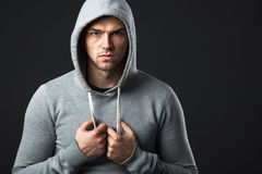 Portrait of brutal looking young guy in sportswear. Royalty Free Stock Images