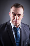 Portrait of brutal man in a business suit. Portrait of a brutal man in a business suit, dark background Stock Photos
