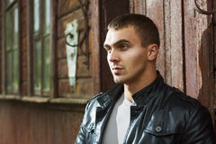 Brutal young man in a leather jacket Royalty Free Stock Images