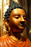 Portrait of the Buddha. Colored statue on the Stock Image
