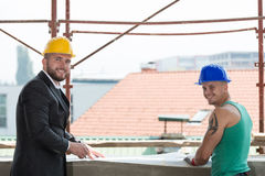 Portrait Of Builder And Businessman Working At Construction Stock Image