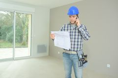 Portrait builder carrying out home improvements. Portrait of builder carrying out home improvements royalty free stock photos
