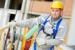 Portrait of builder facade painter at work Royalty Free Stock Photo