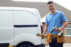 Portrait Of Builder With Van Outside House stock photography