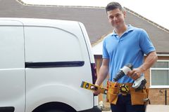 Portrait Of Builder With Van Outside House royalty free stock image