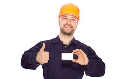 Portrait of the builder with visiting card on a wh Royalty Free Stock Photo