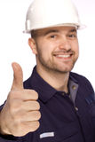 Portrait of a builder in a white helmet on a white Stock Photo