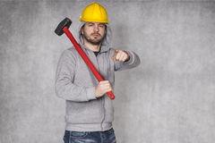 Portrait of a builder who shows you Royalty Free Stock Photos