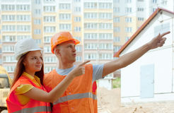 Portrait of builders at building site Stock Photos