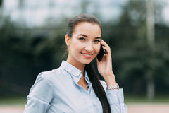 Portrait buisness women. Portrait of a beautiful successful girl, business woman, young with long hair Royalty Free Stock Photo