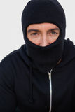 Portrait of a burglar with black jacket and balaclava Stock Images