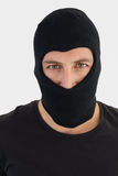 Portrait of burglar wearing a balaclava. On white background Royalty Free Stock Photography