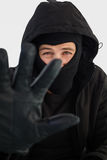 Portrait of burglar wearing a balaclava. On white background Stock Photo