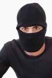 Portrait of burglar wearing a balaclava. On white background Royalty Free Stock Photos