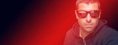 Portrait of burglar wearing sunglasses. On white background stock image