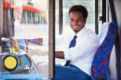 Portrait Of Bus Driver Behind Wheel stock photo