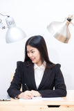 Portrait of business asian woman with laptop writes on a documen Stock Photo