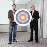 Portrait of business colleagues holding target Stock Photo