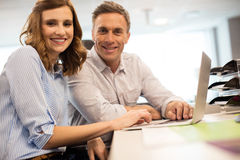 Portrait of business colleagues working together in office Royalty Free Stock Photography