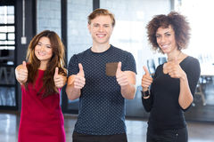 Portrait of business executives giving a thumbs up Royalty Free Stock Image