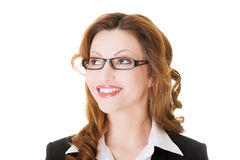 Portrait of business in eyeglasses looking up. Royalty Free Stock Images