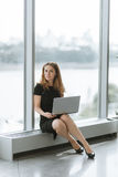 Portrait of business girl. Beautiful office girl with laptop, phone, notebook. Business girl smiling ,successful people Stock Photography