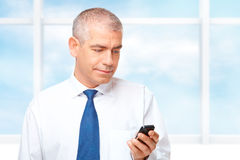 Portrait of  business man. Mature businessman with mobile phone Stock Photos