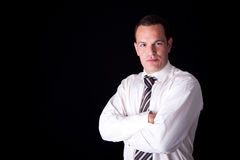 Portrait of a  business man, arms crossed. Isolated on black background. Studio shot Stock Photos