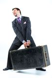 Portrait of a  business man with big old suitcase Stock Photo