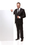 Portrait of business man with blank signboard Stock Photography