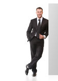 Portrait of business man with blank signboard Royalty Free Stock Image