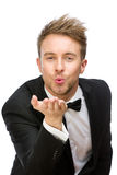 Portrait of business man blowing kiss Royalty Free Stock Images