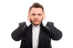 Portrait of business man covering ears like deaf concept. Isolated on white background with copyspace advertising area royalty free stock images