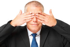 Portrait of business man covering eyes Royalty Free Stock Photo